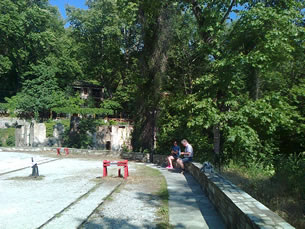 A steep walk from the plateia to the railway station, and a even steep return up to the village centre, Nicole and Raymond take a little rest moment